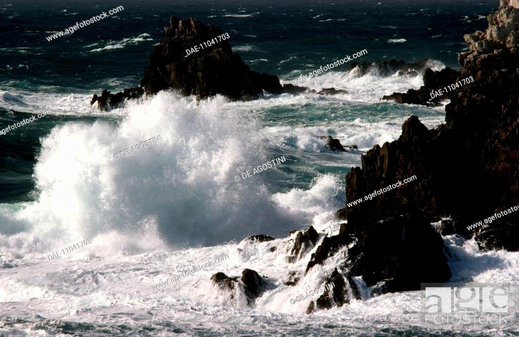 Stock Photo: Rough sea, waves breaking on the rocky coast of the Island of Ouessant, Finistere, Brittany, France.