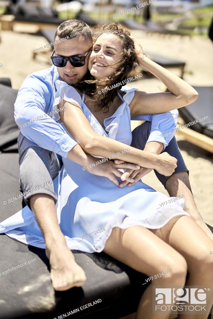 Stock Photo: couple sitting on sunbeds, vacations, summer, love.