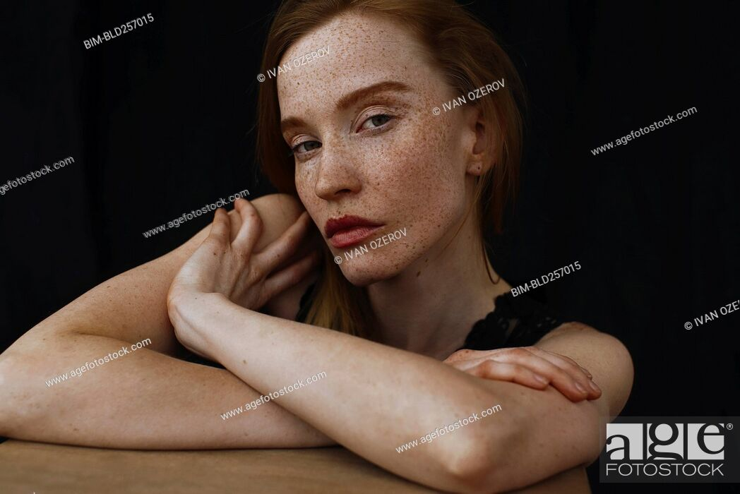 Stock Photo: Close up of serious Caucasian woman with freckles.