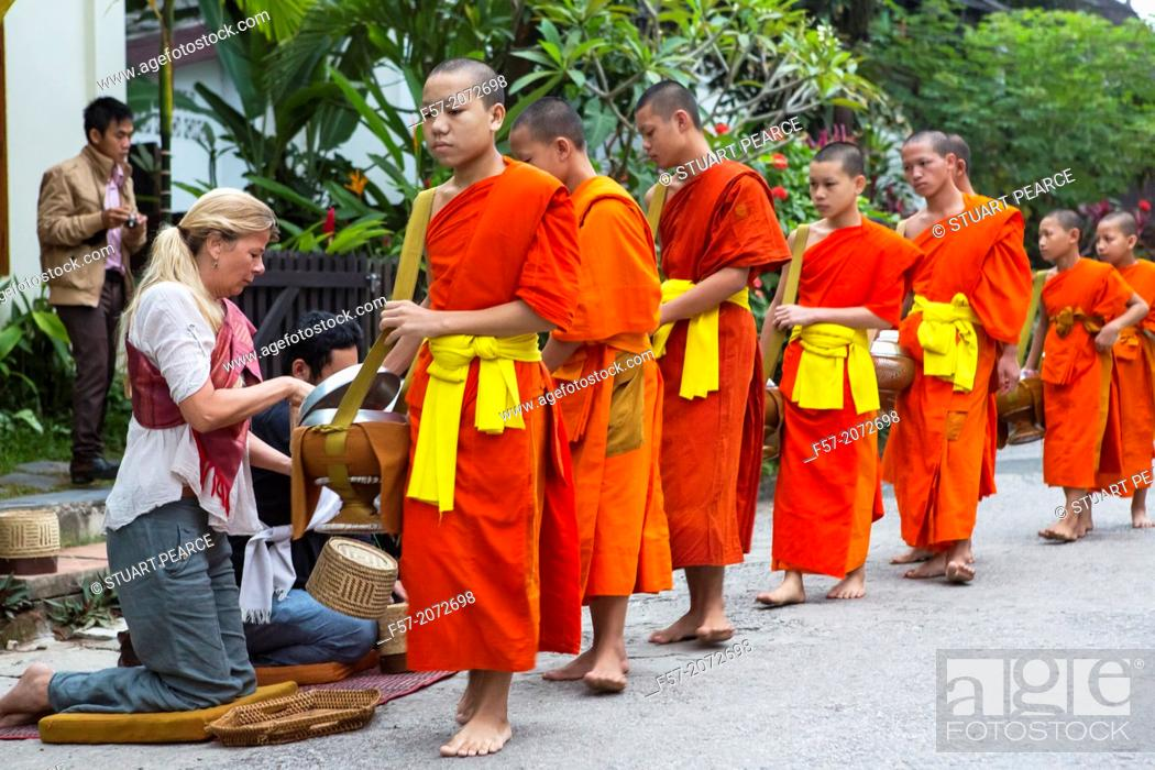 Stock Photo: Alms giving ceremony in Luang Prabang, Laos.