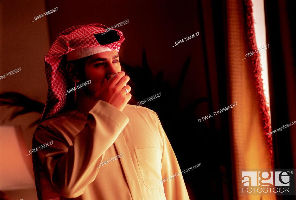 Stock Photo: Arab man drinking coffee.