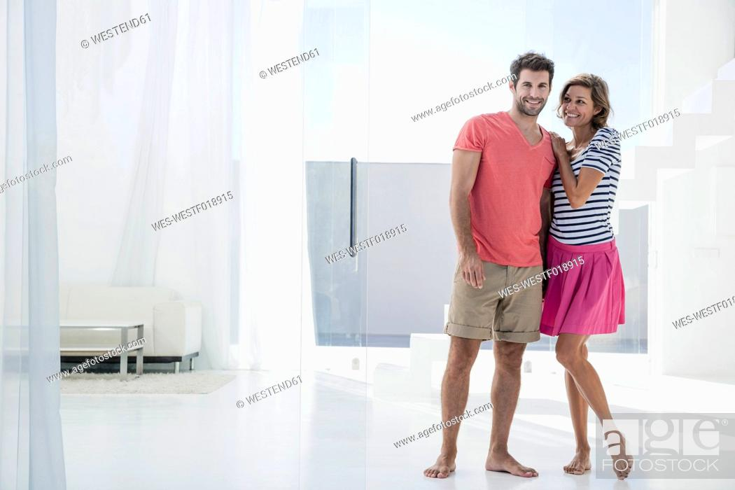 Stock Photo: Spain, Mid adult couple in modern apartment.