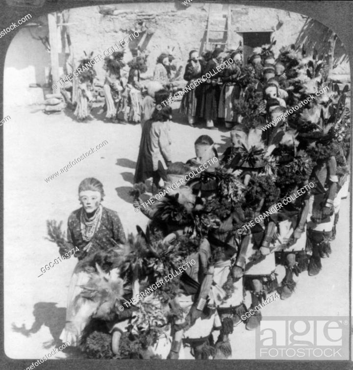 Stock Photo: KACHINA DANCE, c1903.Hopi rainmaking ceremony with kachina masks in the village of Shonghopavi, Arizona. Stereograph, c1903.