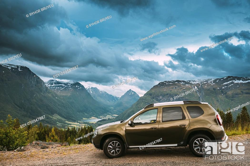 Stock Photo: Utvik, Sogn Og Fjordane County, Norway. Car Suv Parked Near Scenic Route Road In Norwegian Mountain Lake Landscape. Innvikfjord Is A Sub-fjord Of Nordfjord In.