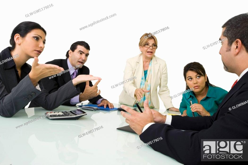 Stock Photo: Five business executives discussing in a meeting.