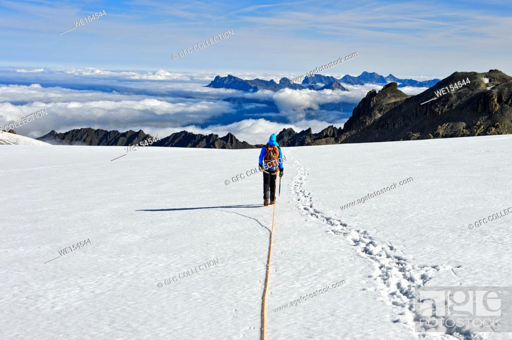 Stock Photo: Alpinist on the glacier Plateau du Trient, view towards the Rhone Valley, Valais, Switzerland.