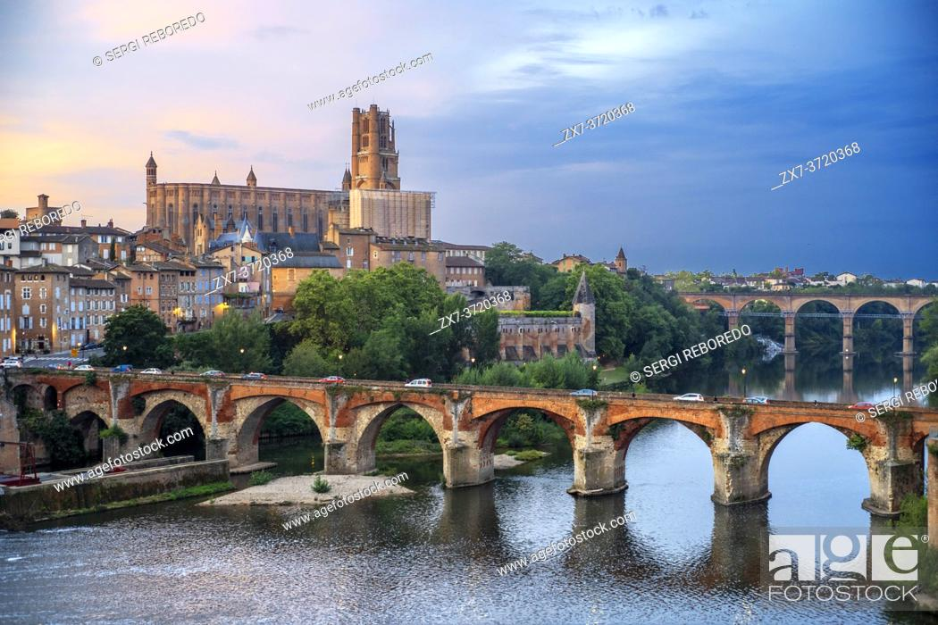 Stock Photo: The Tarn River crossing Albi town. Pont Vieux bridge and the Church of Notre Dame du Breuil in Tarn village, Occitanie Midi Pyrenees France.