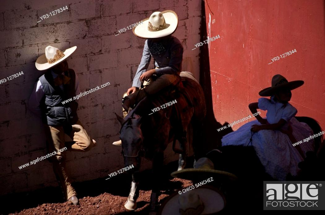 Stock Photo: A Mexican charro waves at the National Charro Championship in Pachuca, Hidalgo State, Mexico. Escaramuzas are similar to US rodeos.