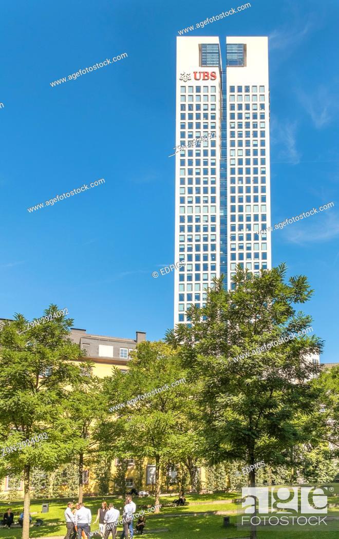 Stock Photo: bankers taking a lunch break, opernturm, opera tower, german headquarters of swiss bank ubs in background, financial district, frankfurt/main, hesse, germany.