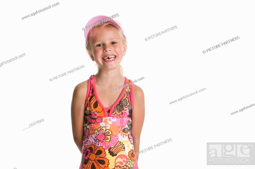 Stock Photo: Portrait of a blond girl with a cap.