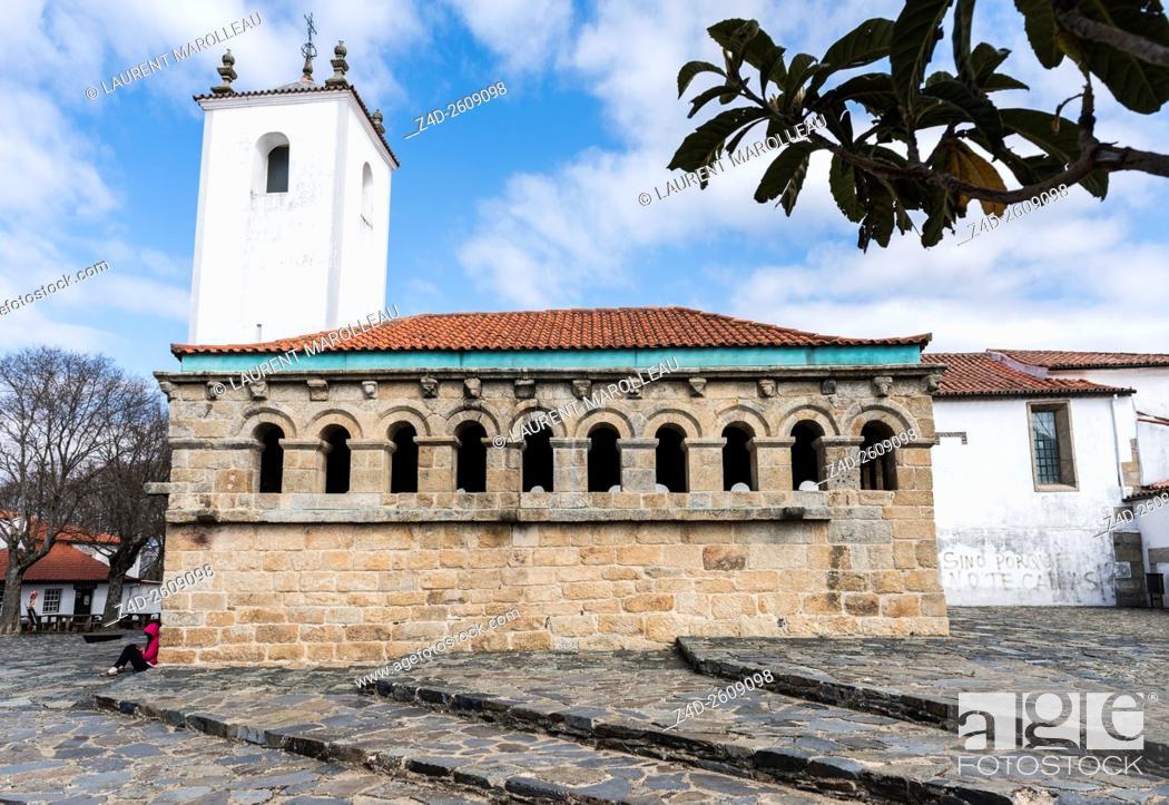 Stock Photo: The Ancient Domus Municipalis of Braganca and Church of Santa Maria do Castelo in the background. Braganca, Braganca District, Norte Region, Portugal, Europe.