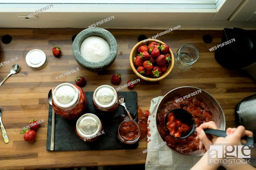 Stock Photo: Preparing strawberry jam at home.