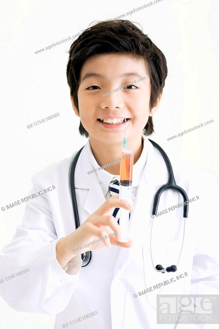 Stock Photo: boy in experiment gown.