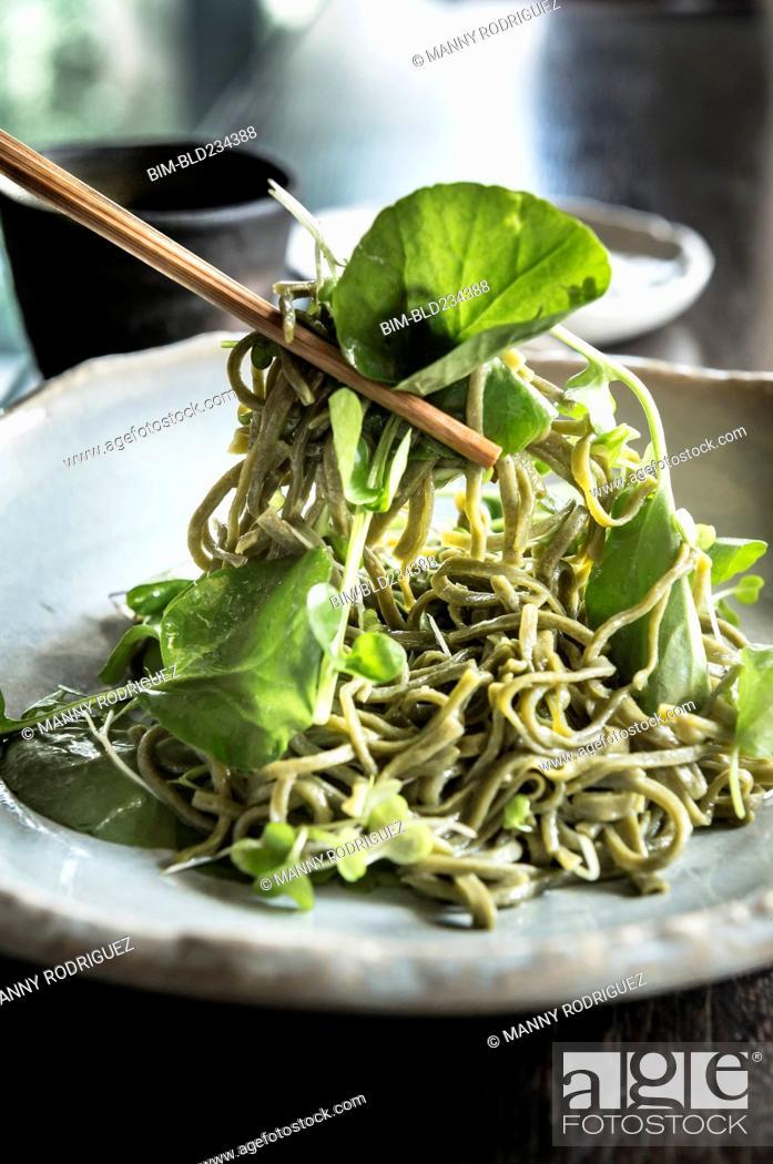 Stock Photo: Chopsticks lifting soba salad noodles.