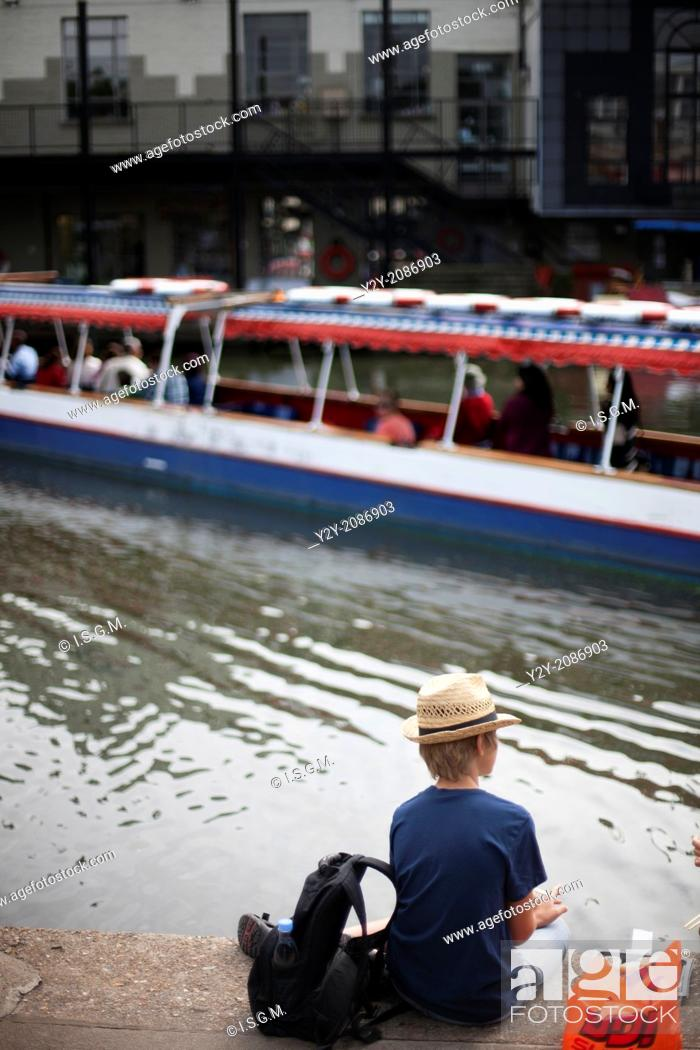 Stock Photo: Boy looking the river in Candem Town, London, England, UK.