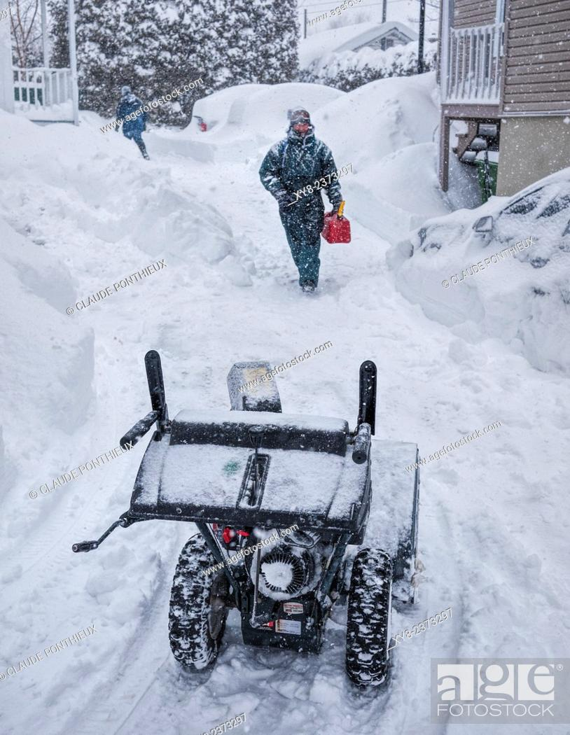 Stock Photo: Man about to use his snow-blower, Sherbrooke, Quebec, Canada.