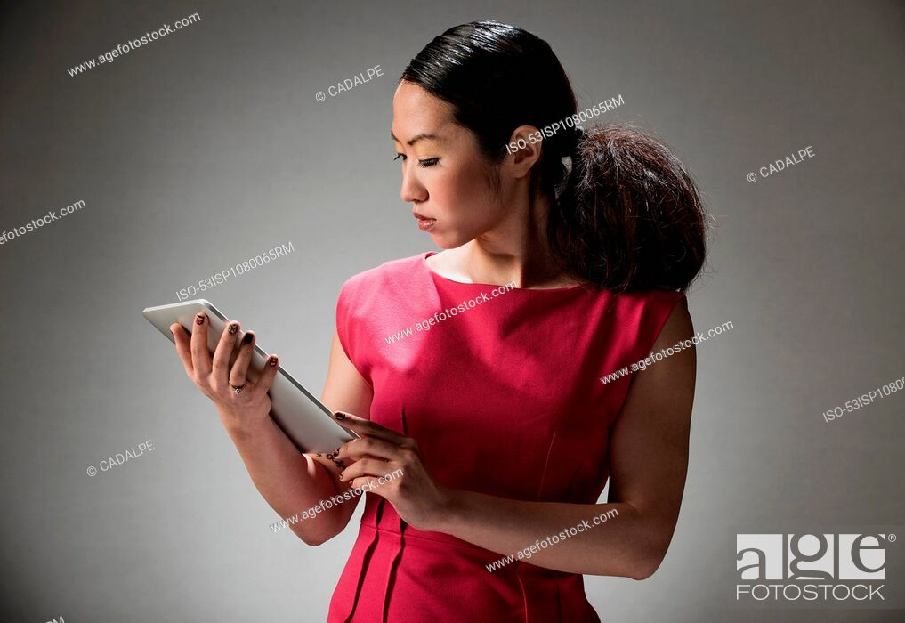 Stock Photo: Businesswoman using tablet computer.