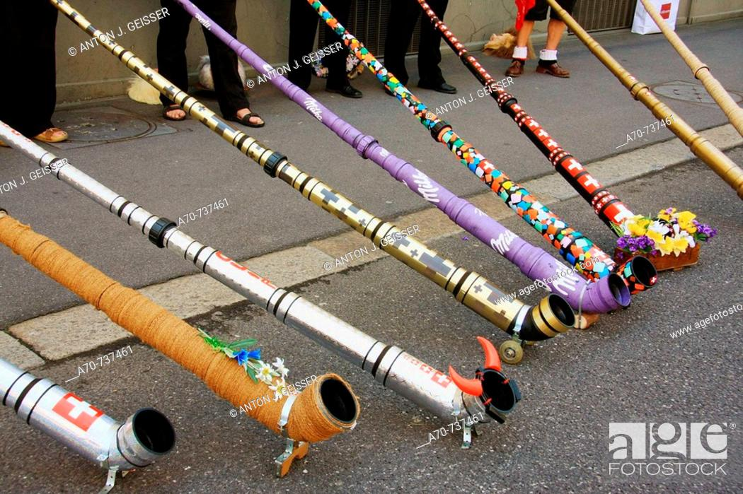 Stock Photo: Alternative alphorns made of metal and plastic. Yodeling festival, Lucerne 2008, wtih 12.000 active yodelers and 200.000 visitors. Switzerland.