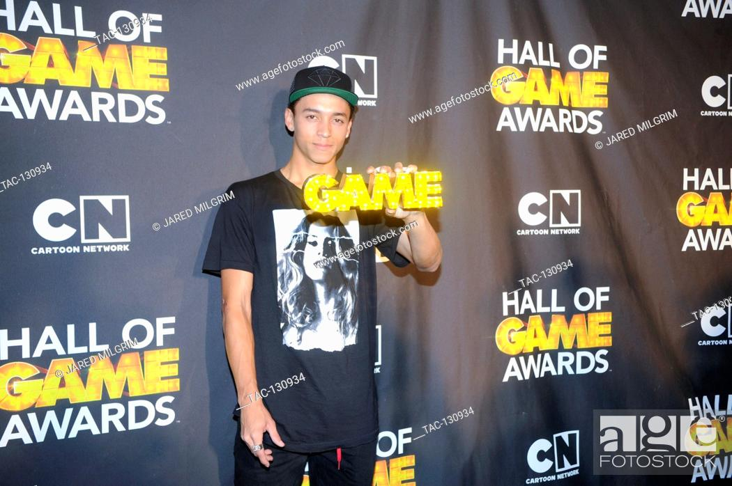 Stock Photo: Pro skater Nyjah Huston attends the Third Annual Hall of Game Awards hosted by Cartoon Network at Barker Hangar on February 9, 2013 in Santa Monica, California.