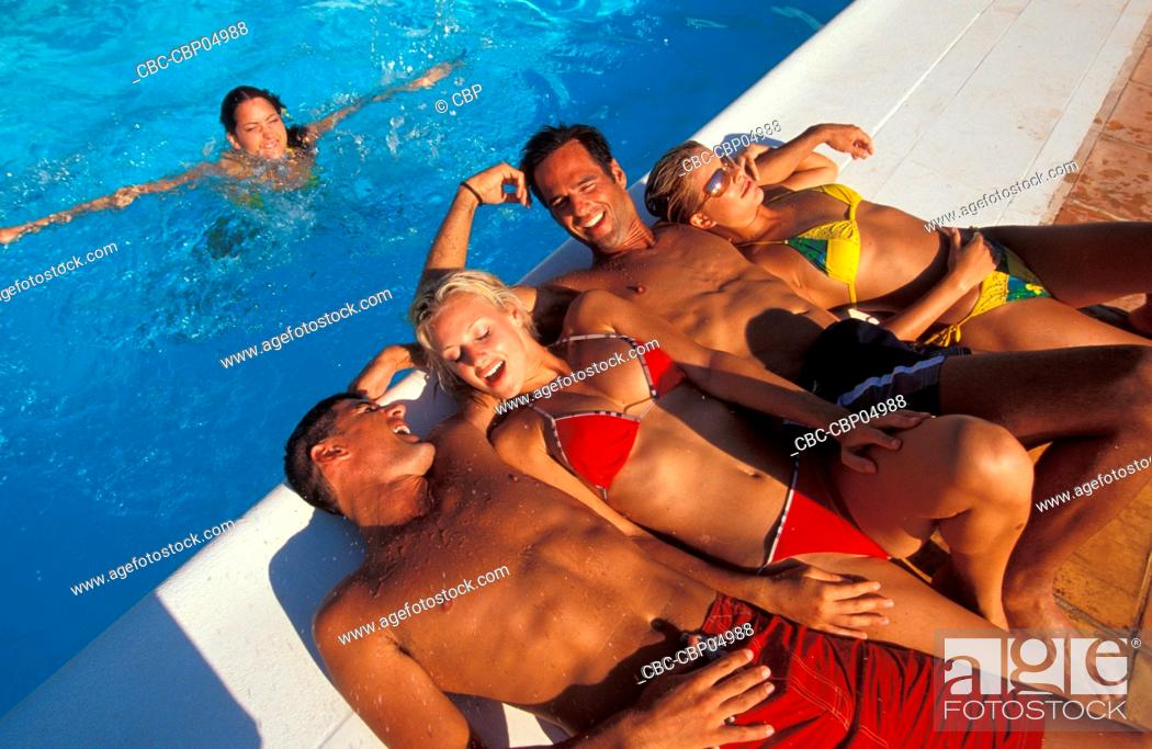 Imagen: Group Of Young People Lying Out By Pool.
