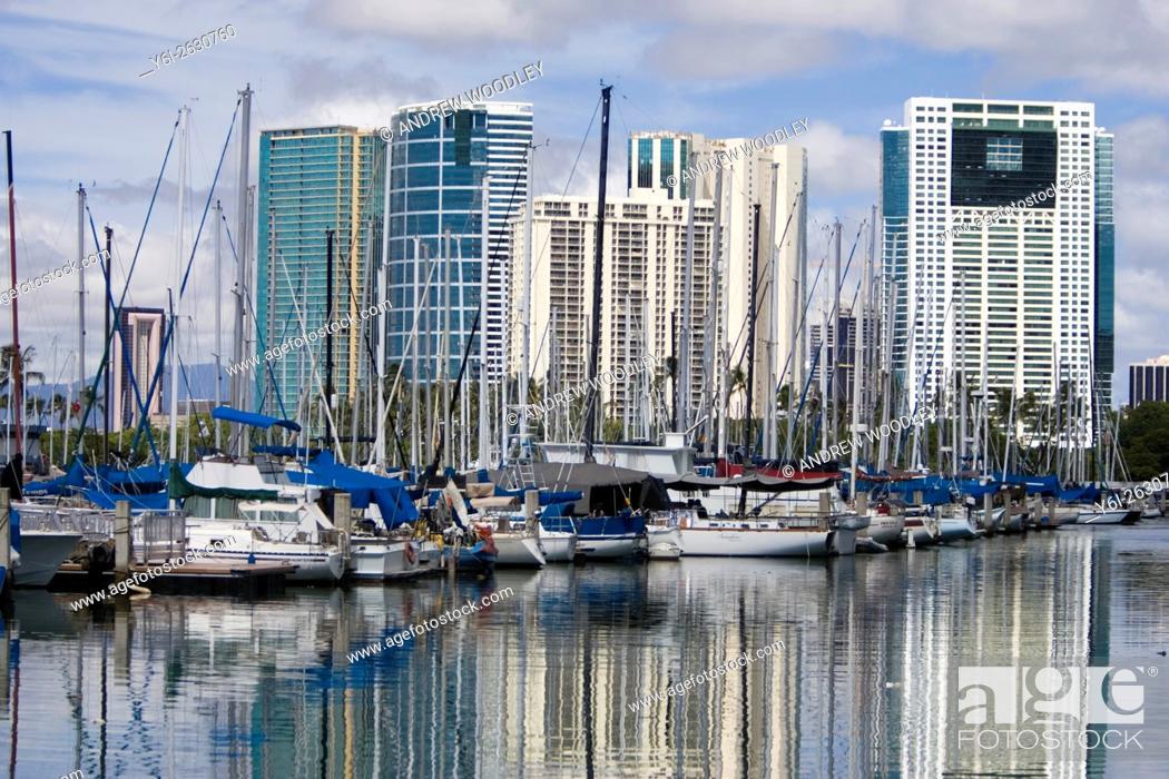 Stock Photo: Ala Wai Boat Harbor boats surrounded by hotels and tower blocks Honolulu Hawaii USA.