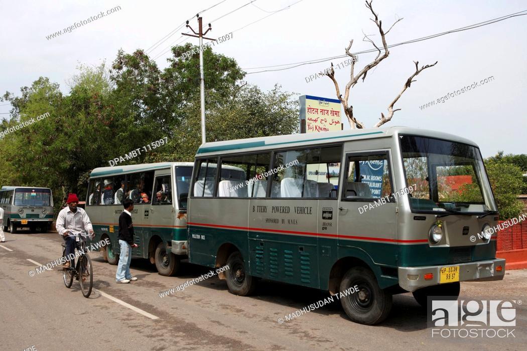 Stock Photo: Environment friendly battery operated bus at Taj Mahal Seventh Wonders of World Agra ; Uttar Pradesh ; India.