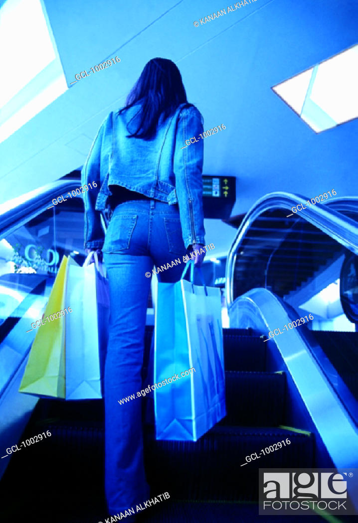 Stock Photo: Woman with shopping bags in a shopping mall.