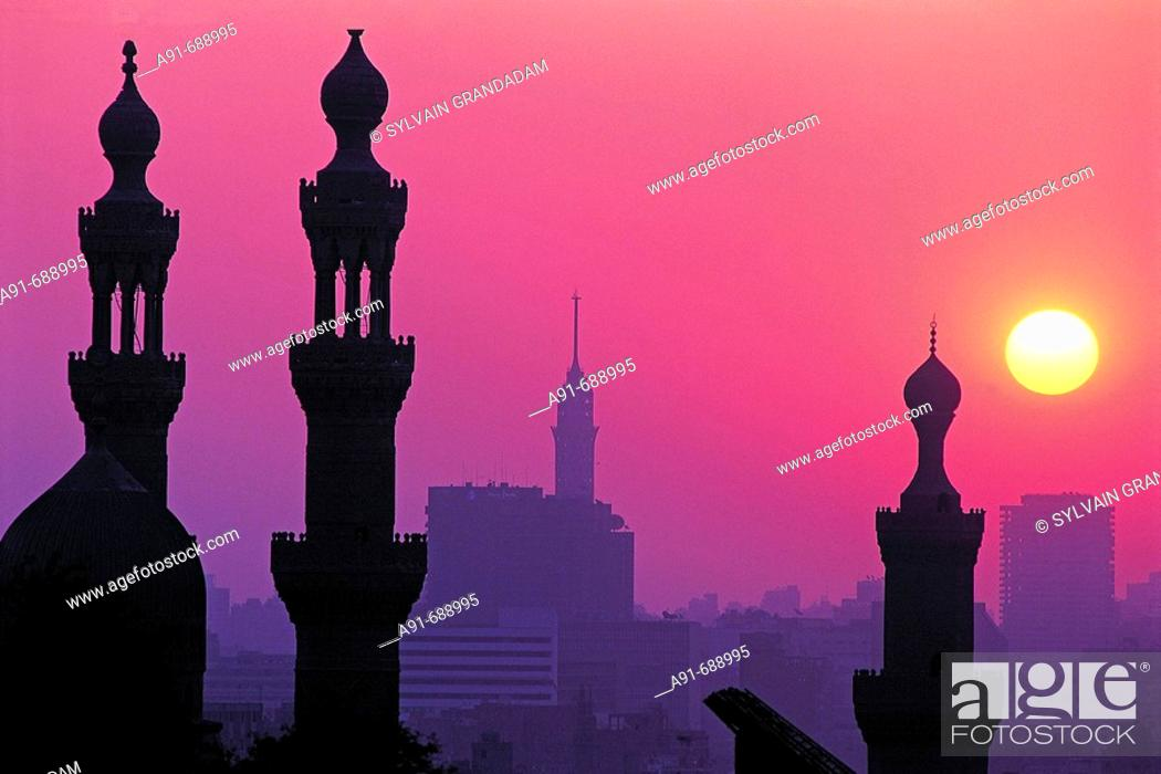 Stock Photo: Minarets of Hassan mosque at sunset, view from citadel .City of Cairo. Egypt.
