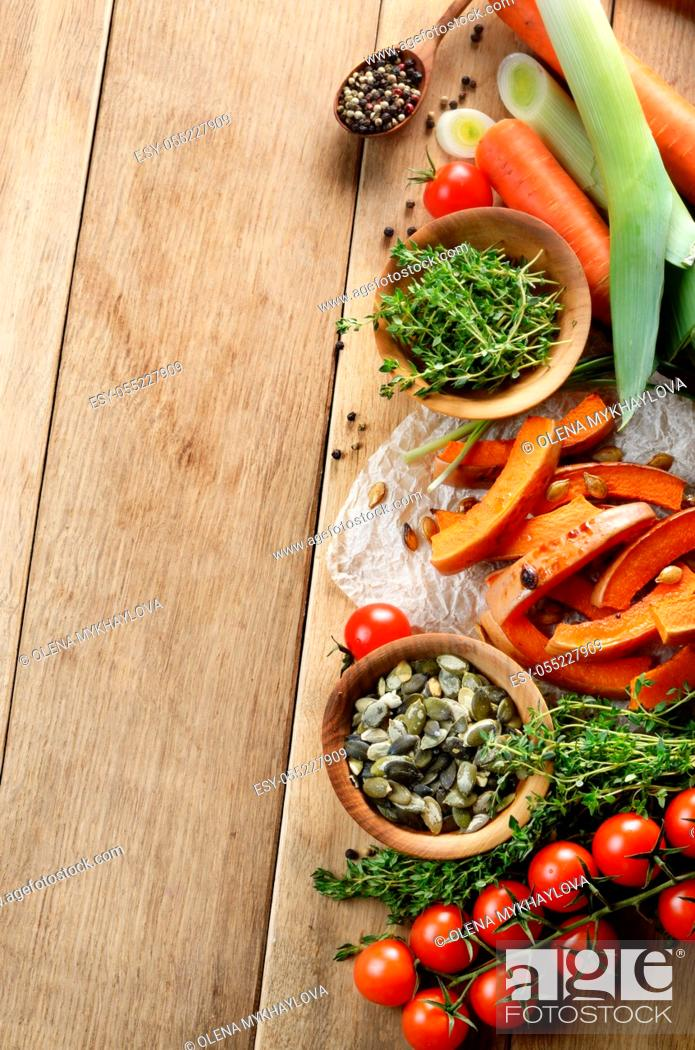 Stock Photo: Fresh Organic Vegetables on a Wooden Background with Space For Your Text.