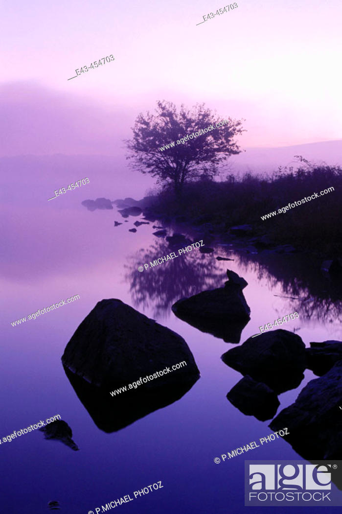 Stock Photo: Lake and mist with rocks and magenta colors, USA.