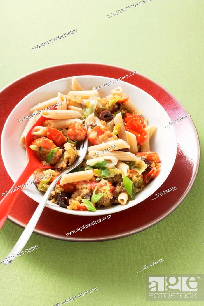 Stock Photo: Pasta siciliana with tomatoes, olives and anchovy fillets.
