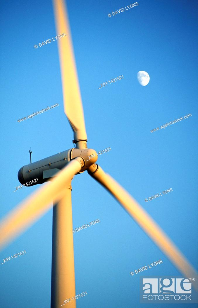 Stock Photo: Wind turbine rotors with blue sky and moon generating electricity on wind farm at Bryn Titli near Rhayader, central Wales, UK.