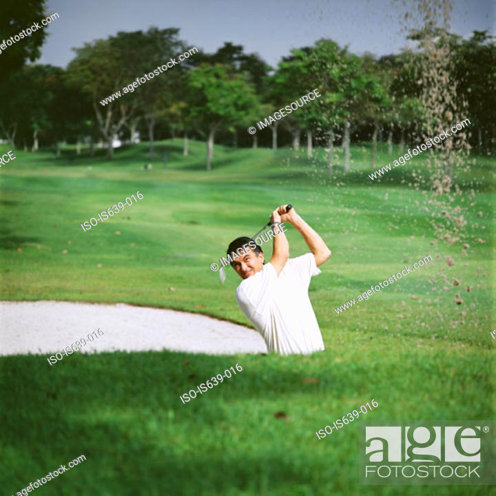 Stock Photo: Golfer in sand trap.