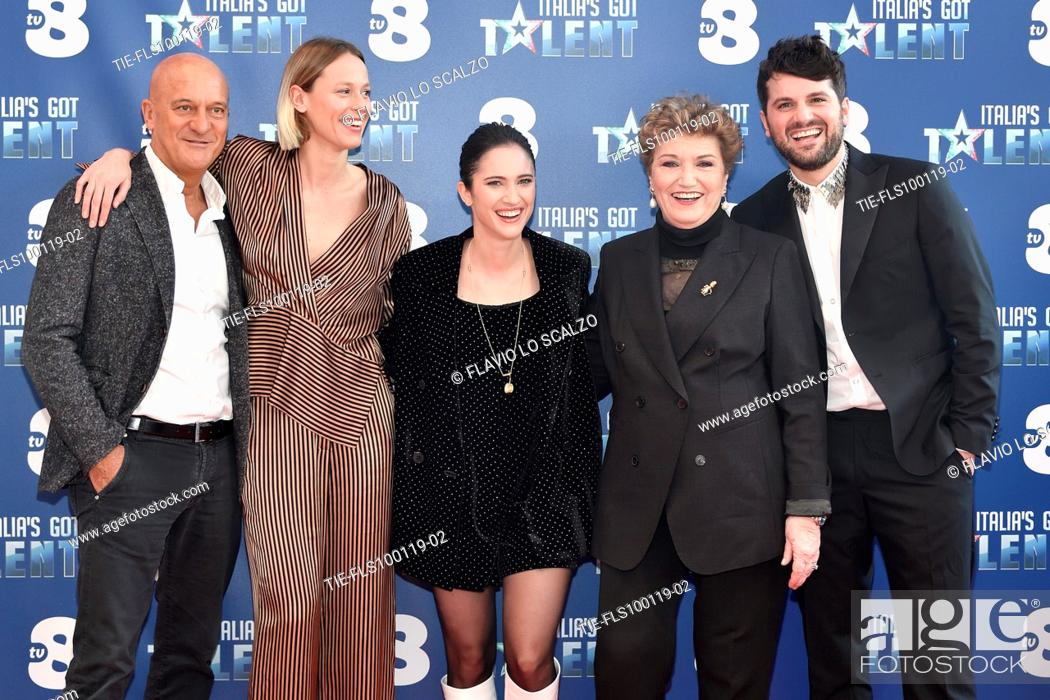 Stock Photo: The actor Claudio Bisio, swimmer Federica Pellegrini, singer Lodovica Comelli, record producer Mara Maionchi and the actor Frank Matano during the photocall of.