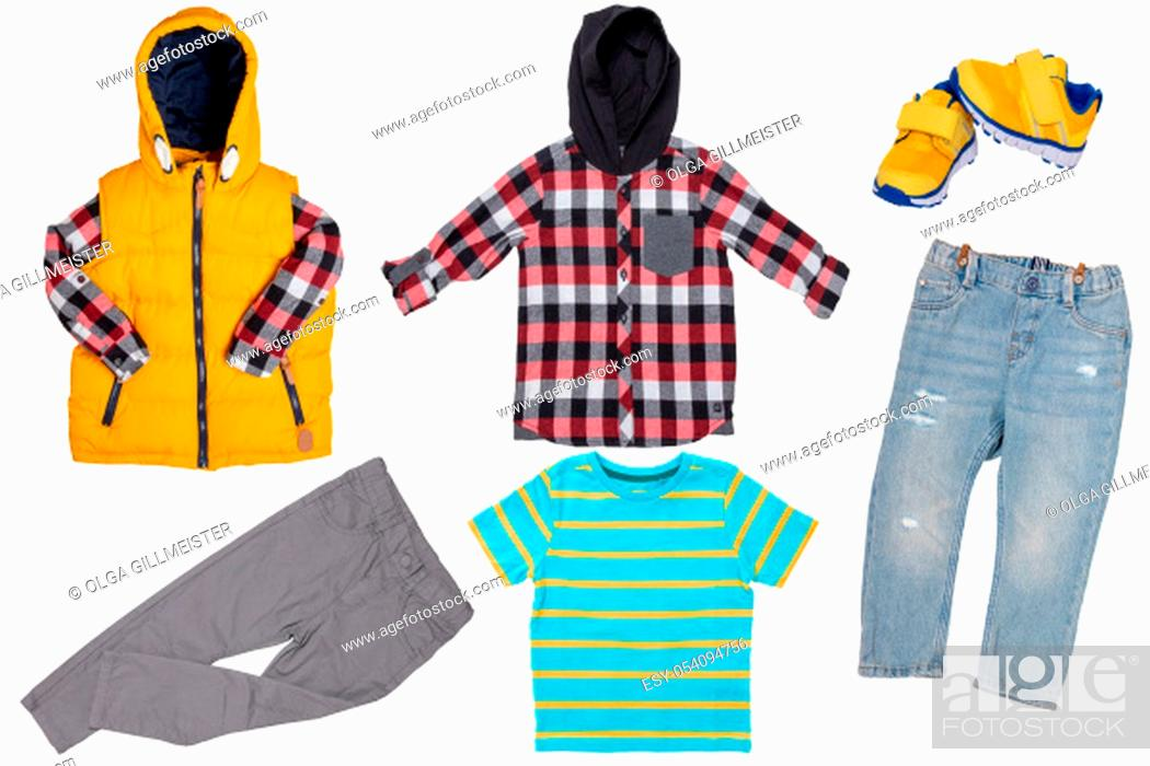 Stock Photo: Collage set of children clothes. Denim jeans or pants, a pair shoes , a yellow down vest with shirt, shirt and a hoodie shirt for child boy isolated on a white.