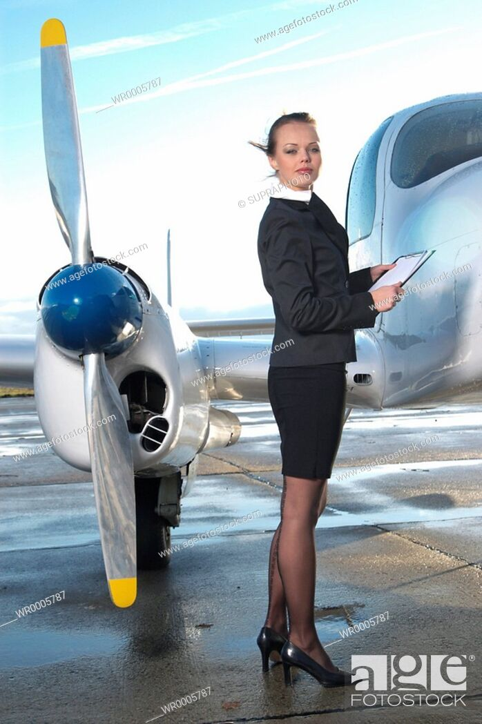 Stock Photo: Hostess plane Supraphoto.