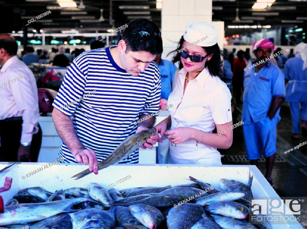 Stock Photo: Tourists on the fish market in Dubai, United Arab Emirates.