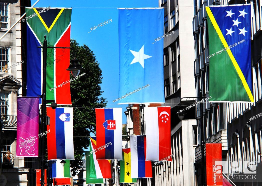 Stock Photo: Flags of the world displayed in Jermyn Street near Piccadilly Circus in the heart of London, England, during the 2012 Olympics period.