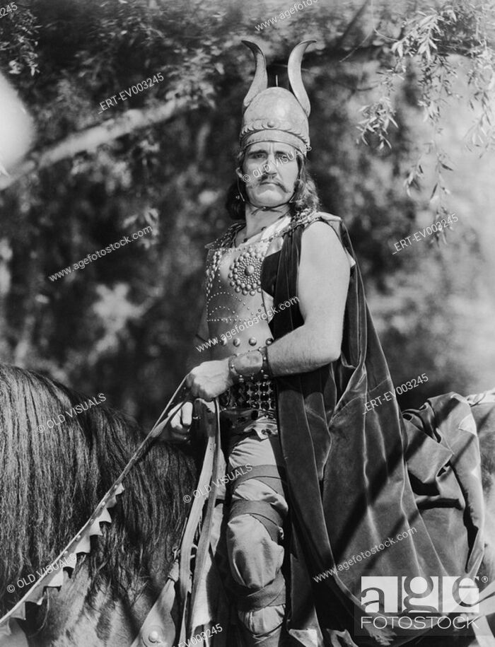 Stock Photo: Portrait of Viking man on horseback All persons depicted are not longer living and no estate exists Supplier warranties that there will be no model release.