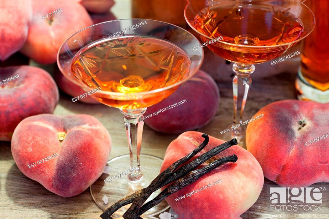 Homemade vineyard peach liqueur in