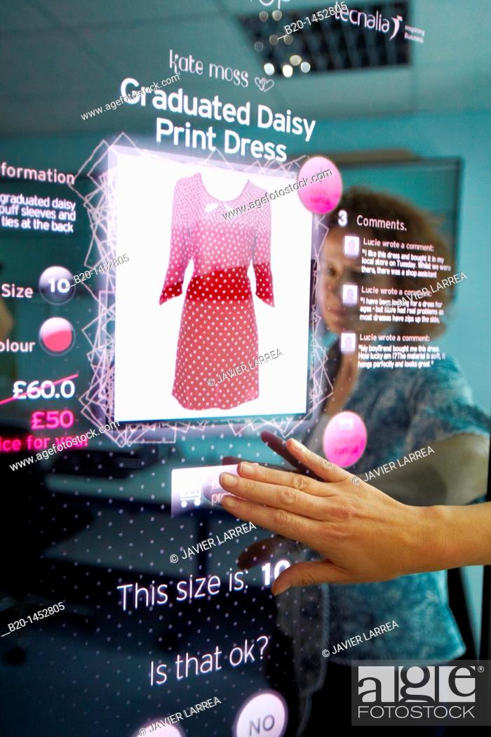 Stock Photo: Interactive mirror that allows the person standing in front of it to see a simulated view of how the clothes they wish to buy would look when they wear them.