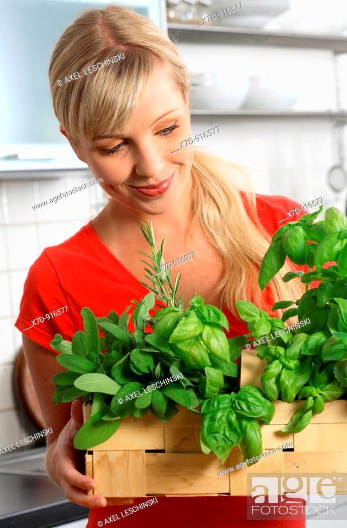 Stock Photo: woman with basket of fresh herbs.
