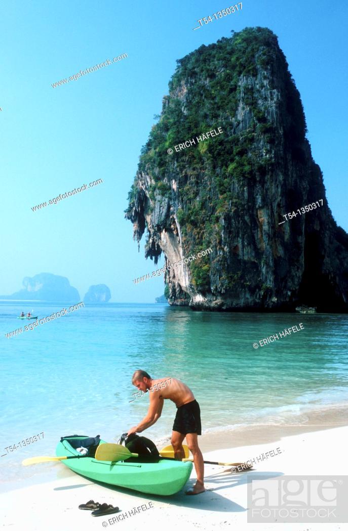Stock Photo: Canoe Tourist on the beach at Railey, Thailand.