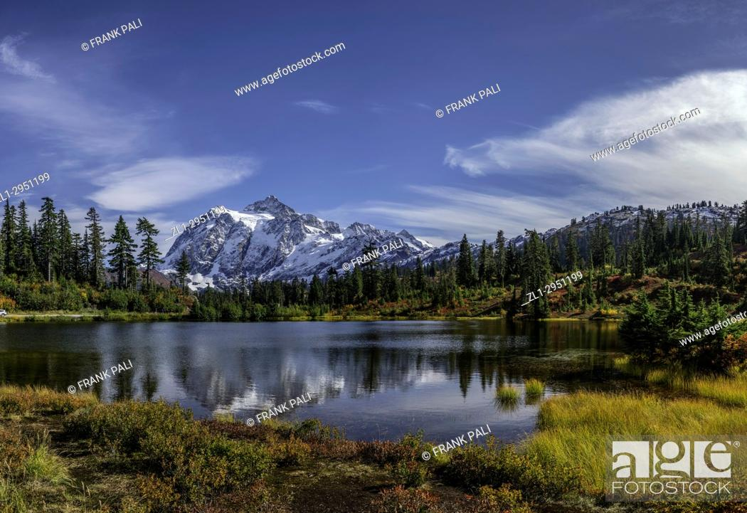 Stock Photo: WASHINGTON - Mount Shuksan reflecting in Picture Lake in Heather Meadows Recreation Area in the North Cascades. Fall colours are abundant in the vegetation.