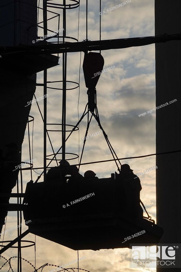 Stock Photo: Kiev, Ukraine A crane lifts workmen in Podil, a hip and working class section of town.