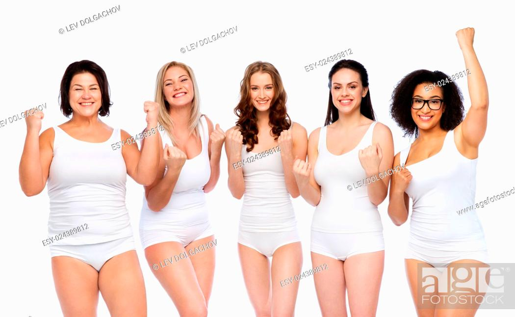Stock Photo: success, friendship, beauty, body positive and people concept - group of happy plus size women in white underwear celebrating victory.