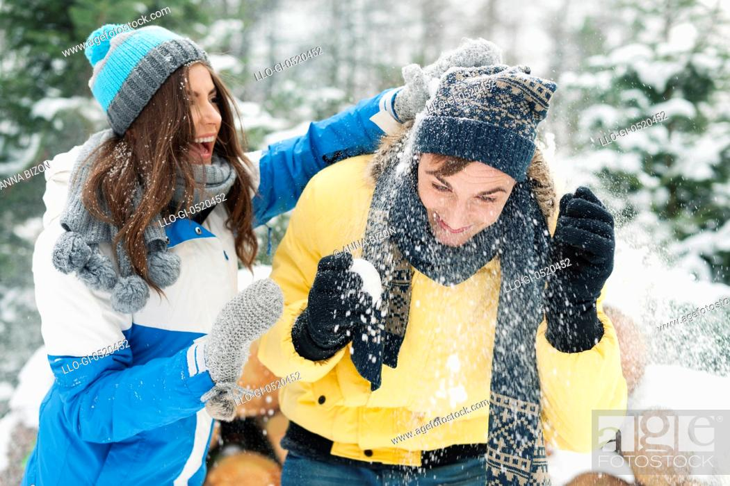 Stock Photo: Young couple have fun during the snowball fight. Debica, Poland.