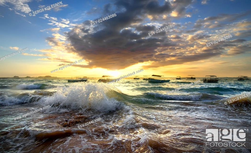 Photo de stock: Fishing boats in the ocean at sunset.