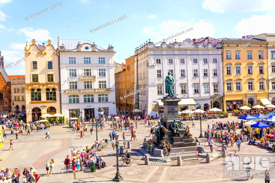 Stock Photo: Adam Mickiewicz monument and tourists walking in the Old Market Square, and beautiful tenement houses, view from above, Krakow, Poland.