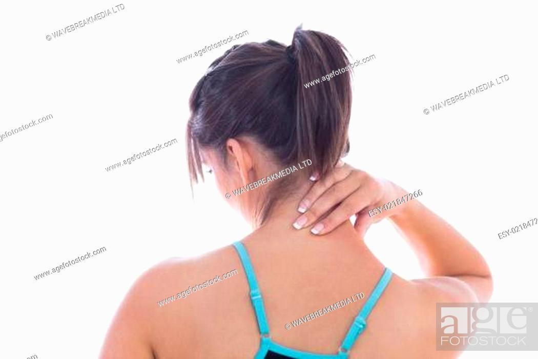 Stock Photo: Rear view of young woman with neck pain.
